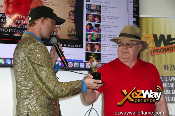Newport Beach, California, USA. 7th June, 2021. Eric Zuley presents Brian N. Willis with an award at the EZWay Network's 'From Zero to Wealth TV Show Celebration' held at a private location in Newport Beach, California. Credit:  Sheri Determan