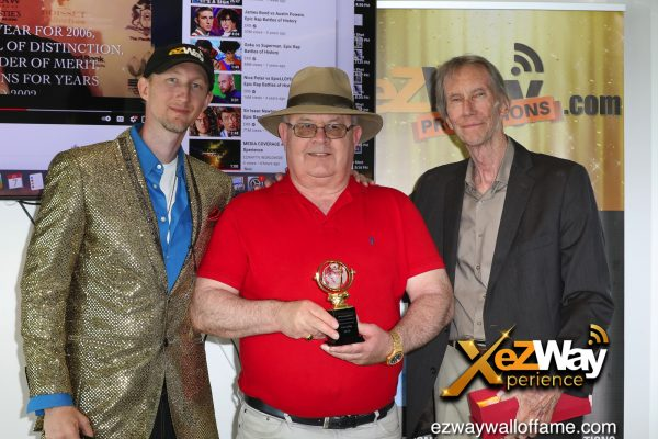 Newport Beach, California, USA. 7th June, 2021. Eric Zuley, Brian N. Willis holding his award and James Zuley at the EZWay Network's 'From Zero to Wealth TV Show Celebration' held at a private location in Newport Beach, California. Credit:  Sheri Determan